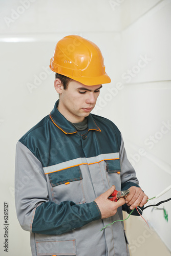 Electrician at cabling work