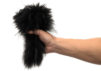black fur in his hand on a white background