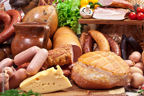 Variety of sausage products, cheese, eggs and vegetables.