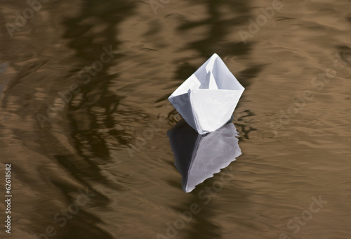 paper boat floating in the creek