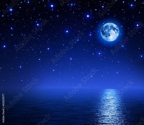 super moon in starry sky on sea