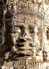 Stone face on towers of Bayon temple closeup
