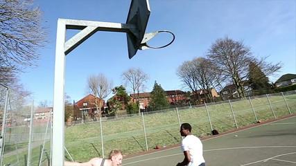 Basketball game where one player slam dunks-ver 2