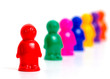Colorful toy people group in queue on white background