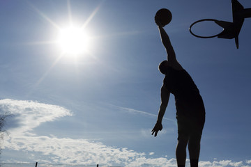 Basketball player slam dunk silhouette with copy space
