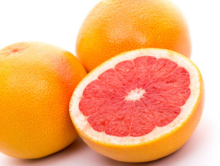 set of three grapefruits on white