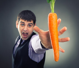 Man trying to reach fresh carrot