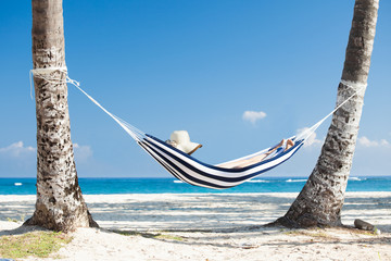 Woman In Hammock At Beach