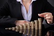 Businesswoman With Row Of Coins
