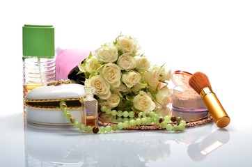 Women's jewelry, cosmetics and flowers in still life
