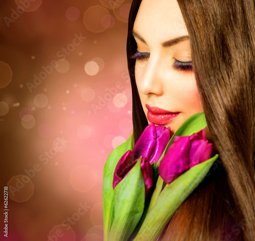 Beauty Woman with Spring Flower bouquet