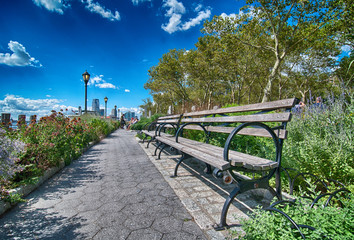 NEW YORK CITY - AUG 6: Tourists walk along city streets, August