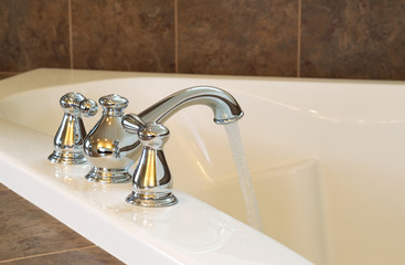 New Chrome Faucet in Master Bath Tub
