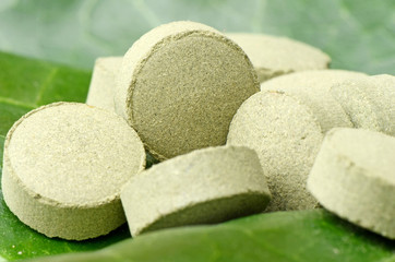 Plain Compress Tablet of Medicinal Herb Powder.