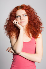 Portrait thinking red haired girl