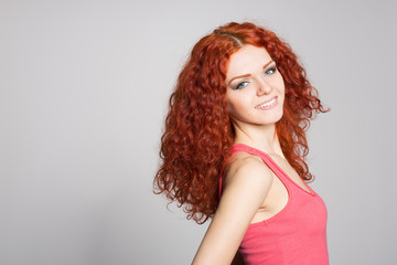 Portrait smiling young woman with red hair