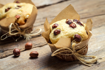 Closeup of vanilla muffin with nuts