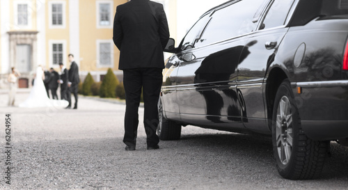 Black limo at wedding