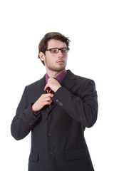 Serious businessman checking his tie