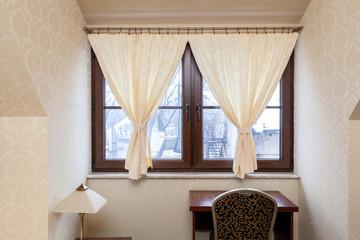 Decorative hangings in window