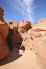 Entrance to Antelope Canyon Against Blue Sky