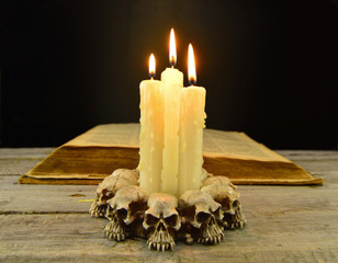 Evil candles with old book