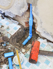 repairs of home clean water plumbing tube and heavy hammer and r