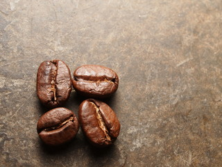 Roasted Coffee beans on texture floor