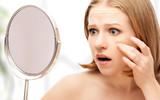 Fototapety beautiful healthy woman  frightened saw in the mirror acne and w
