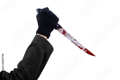 A hand holding bloody knife isolated