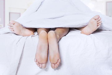 Pairs of feet in a bed 1