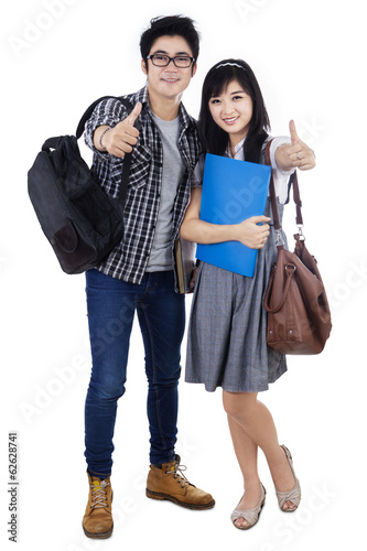 Portrait of college students showing thumbs-up
