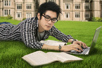 Male highschool student studying outdoor