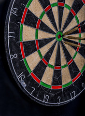 darts in the center of a dartboard