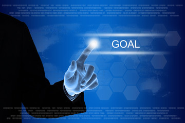 business hand clicking goal button on touch screen
