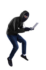 A thief is stealing a laptop computer