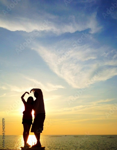 silhouette of lover make sign of love (heart)