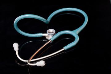 Stethoscope isolated on black background.