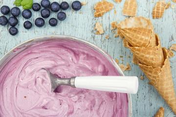 Blueberry ice cream on wooden background