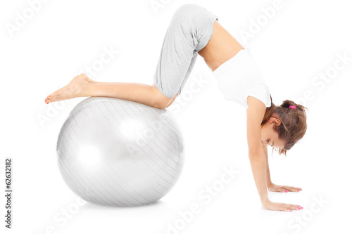 Woman exercising with a ball