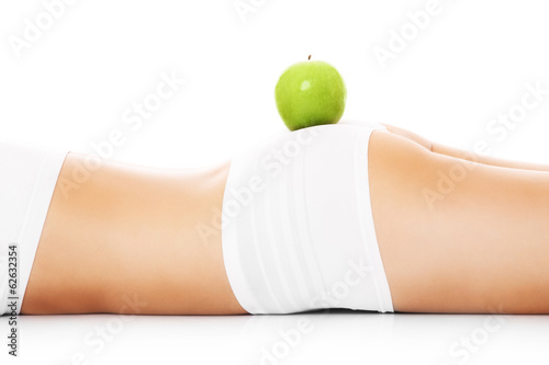 Green apple on body