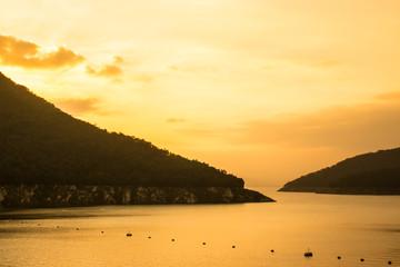 Rising sun at dawn over the mountain of Bhumibol Dam, Thailand