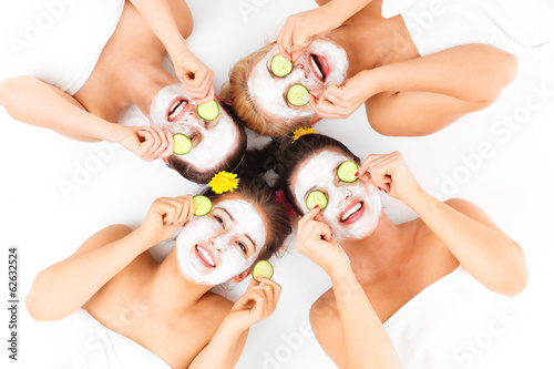 canvas print picture Four friends enjoying time in spa