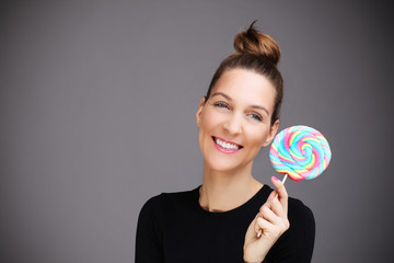 Happy woman with lollipop