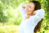 Fototapety Beautiful Young Woman Outdoor. Enjoy Nature