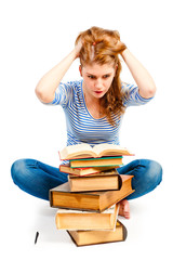 student with bulging eyes reading a book