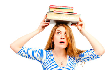 beautiful girl holding pile of books over his head