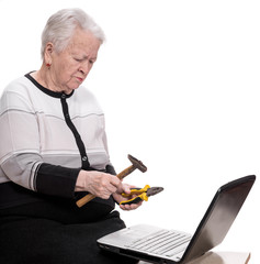 Old woman with holding hammer and pliers