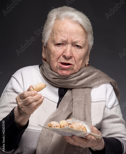 Old woman choking with cookie