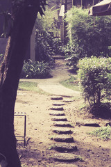 Stone block walk path in the park Vintage style with retro filte